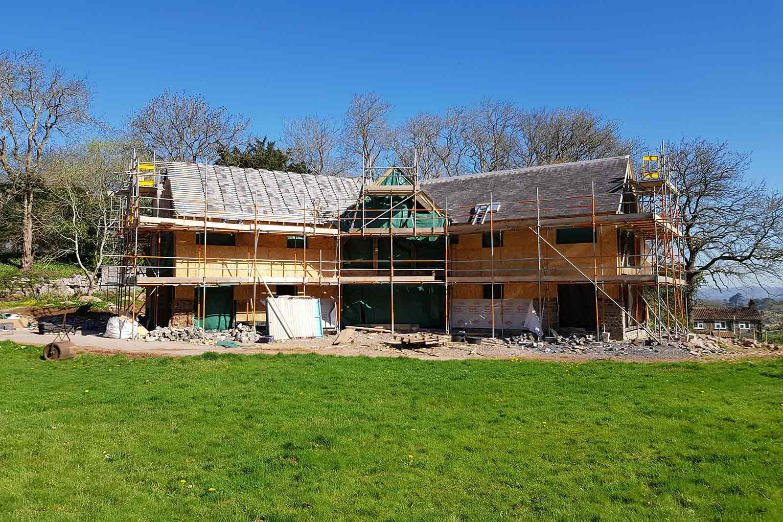 The exterior of a bespoke turnkey home showing the oak frame